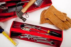 A red toolbox with miscellaneous tools Stock Photos