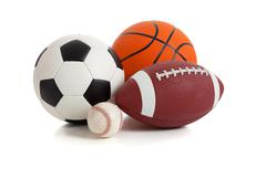 Assorted sports balls on white Stock Photos