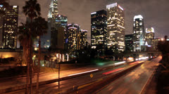 Time Lapse of Traffic in Downtown Los Angeles at Night - 4K - stock footage