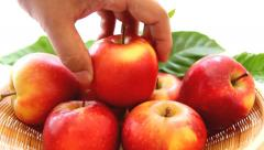Picking up red apple from the basket Stock Footage