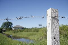 barbed iron fence - stock photo