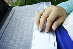Hand control on touchpad Stock Photos