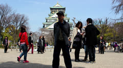 Time lapse of people walking Osaka Castle in Osaka, Japan, March 2013. Stock Footage
