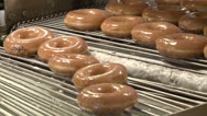 Stock Video Footage of BAKERY DONUTS ON CONVEYOR MACHINE WITH GLAZE SUGAR HD 1080