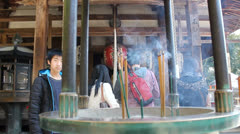 Incense burning at the Golden Temple in Kyoto, Japan. Stock Footage