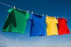 primary colored t-shirts on a clothesline - stock photo