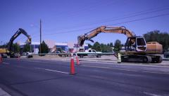 1022 excavator at road construction laying pipe Stock Footage