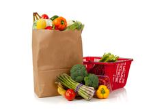 group of fresh produce in a brown grocery sack - stock photo