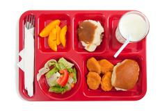 School lunch tray with food on it on a white backgrounf Stock Photos