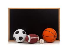 Assorted sports balls with a chalkboard background Stock Photos