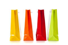Multi colored shopping bags on a white background Stock Photos