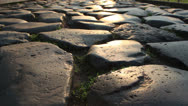 Stock Video Footage of Dolly shot of pebbled ancient road in Rome (1)