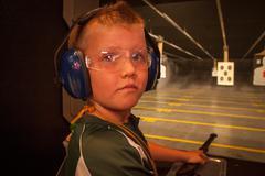 Boy at the Shooting Range - stock photo
