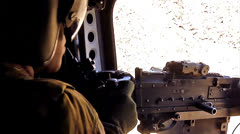 Chinook Gunner And Machinegun 01 - firing 02 Stock Footage