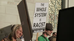 """""""System Is Racist"""" Sign - stock footage"""