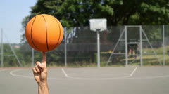 Basketball Player Spinning the ball Stock Footage