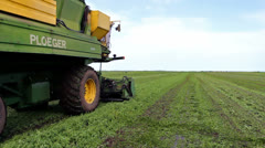 Combine to harvest peas - stock footage