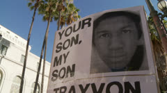 """TRAYVON IS OUR SON"" Sign Stock Footage"