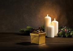 Candles present in christmas setting Stock Photos