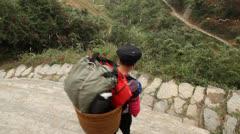 Yao ethnic minority women guide and porter Stock Footage