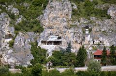 "the rock monastery ""st dimitrii of basarbovo"" in the picturesque valley of th - stock photo"