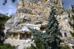 """The rock monastery """"st dimitrii of basarbovo"""" in the picturesque valley of th Stock Photos"""