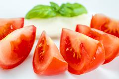 Italian apppetizer tomatoes with mozarella and basil Stock Photos