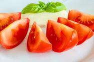 Stock Photo of italian apppetizer tomatoes with mozarella and basil