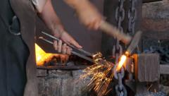 Chain Making - welding the link. - stock footage