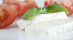 Italian appetizer tomatoes with mozarella and basil - stock footage