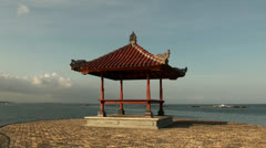 Indonesian relaxing pavilion at seaside Stock Footage
