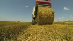 Round Hay Baler Making A Bale Stock Footage