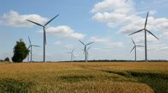 Farm land and wind turbines - stock footage