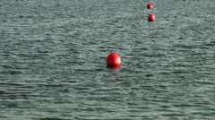 Red security buoys for swimming area border Stock Footage