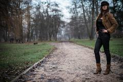 Young woman in jacket standing and posing at the forest Stock Photos