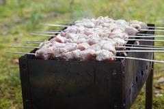 cooking pork shashlik  on skewer - stock photo