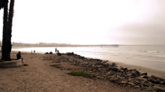 Ventura Beach, California with pier and walkers - stock footage