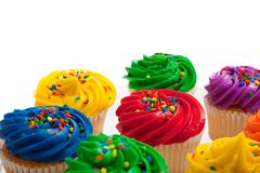 Multi colored cupcakes Stock Photos