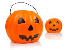 jack-o-lantern buckets on whte - stock photo
