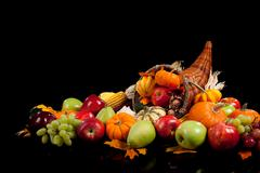 Fall arrangement of fruits and vegetables in a cornucopia Stock Photos
