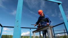 Mature manual worker  shut off oil valve gate on big diameter pipeline - stock footage
