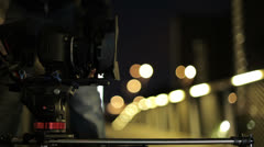 Video dslr camera advancing on slider with beatiful lights in bg Stock Footage