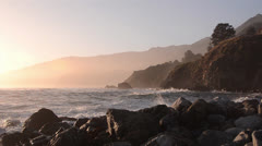 Hazy Sunset and Crashing Waves at Big Sur Stock Footage