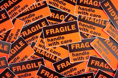 Background of fragile stickers Stock Photos