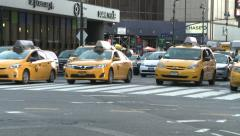 NYC Taxi Cabs at Intersection Stock Footage