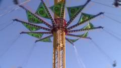 TIMELAPSE AMUSEMENT PARK SWING RIDE IN HIGH DEFINITION 1080 TIME LAPSE Stock Footage