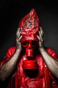 Stock Illustration of horror concept, man with red gas mask.