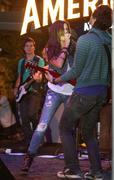 ashley tisdale.ashley tisdale performs at the americana .held at the american - stock photo