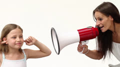 Little girl shouting at Mum with a megaphone Stock Footage