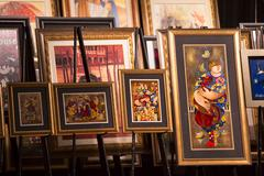 Cruise ship art auction display - stock photo